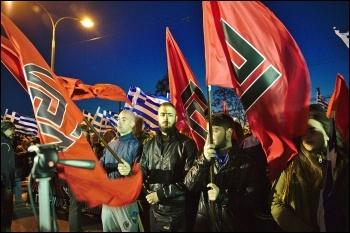 Golden Dawn fascists displaying swastika-like flags, photo DTRocks/CC