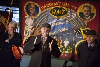 Steve Hedley (centre) speaking at an RMT picket line, photo Paul Mattsson