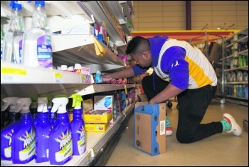 Supermarket worker USAF photo, Jennifer Zima/CC