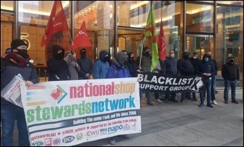 Construction electricians protesting against de-skilling, outside Balfour Beatty, Canary Wharf, London, on 10.3.21. Photo by Isai Priya electricians protesting against de-skilling, outside Balfour Beatty, Canary Wharf, London, on 10.3.21. Photo by Isai Pr