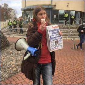Socialist Party member Mia Hollsing addresses a protest in Cardiff. Photo Socialist Party Wales
