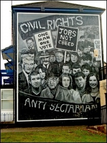 A mural in Derry depicting the 1960s civil rights movement - the beginning of the 'Troubles' in Northern Ireland. Partition by the British ruling class created the Frankenstein monster of sectarianism, that has turned upon its maker, photo Suzanne Mischys