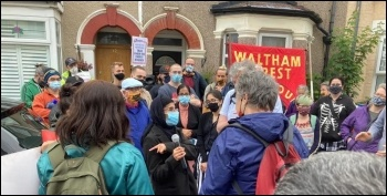 Eviction resistance in Walthamstow, London, 29.6.21. Nadia addressing the crowd after bailiffs say they're not entering her home today!