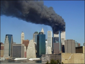 The smoking Twin Towers in New York following the 9/11 attack, photo Michael Foran/CC
