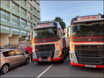 Lorries attempting to drop off shipping containers in the car park. Photo: Nancy Taaffe