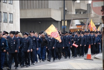 2,500 uniformed firefighters marched with Fire Brigades Union (FBU) flags and placards to protest outside the London Fire Authority (LFA), photo Suzanne Beishon