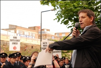 Martin Powell-Davies, NUT, addresses 2,500 uniformed firefighters who marched with Fire Brigades Union (FBU) flags and placards to protest outside the London Fire Authority (LFA), photo Suzanne Beishon