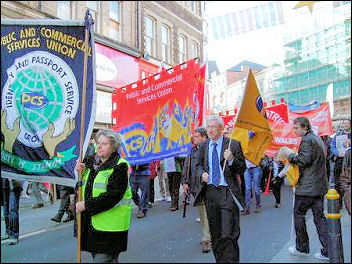 Newport Demo to save the Passport Office: John McInally, Vice president, Public and Commercial Services union, with the IPS group banner , photo Socialist Party Wales