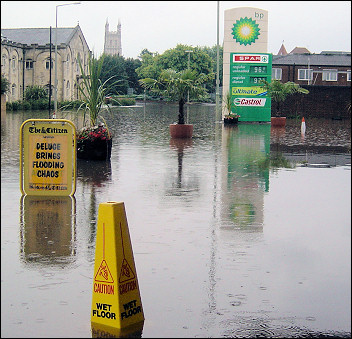 Caution wet floor - flooding in the centre of Gloucester