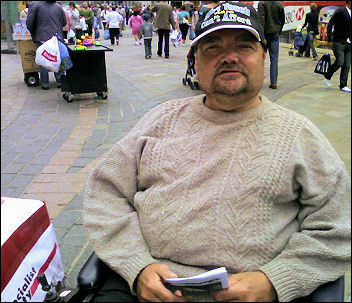 Geoff Wright, campaigning in Leicester against health cuts affecting people with mobility problems, photo Steve Score