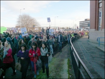 Over 1,400 students from Holy Cross sixth form college and Bury College walked out and marched to a huge rally outside Bury town hall, photo Paul Gerrard