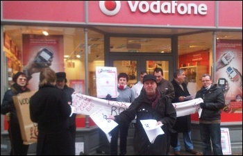 Protesters close Vodafone in Wrexham