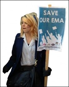 Save our EMA - student demonstrates against the cuts with Youth Fight for Jobs placard
