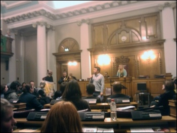 Rob Williams, National Shop Stewards Network anti-cuts convenor, addresses protesters who invaded Lambeth Council's budget meeting, photo by Lambeth  Socialist Party