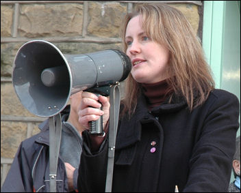 Jackie Grunsell, GP and councillor, speaks at a Save Huddersfield NHS demonstration, photo Huddersfield SP