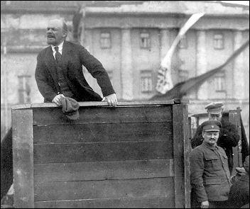 Lenin speaking, Trotsky standing to the right