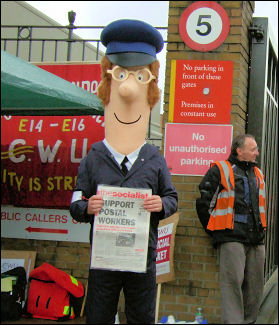 Postman Pat joins the CWU picket line in East London, photo Naomi Byron
