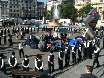 8.42am Police around camp in Trafalgar Square. Presumably to stop rioting. photo and caption Suzanne Beishon