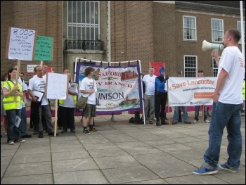 Steve North addressing a rally against the closure of Lancaster House, Salford, photo Hugh Caffrey