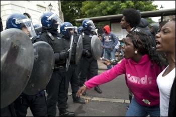 Riot police in Hackney, photo Paul Mattsson