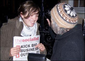 Socialist Party members sell The Socialist, photo Paul Mattsson