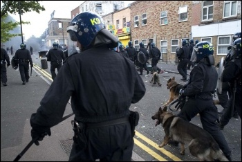 Riot police with dogs, Hackney, August 2011, photo Paul Mattsson