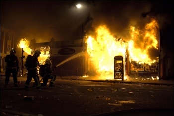Riots: rioters and police in Tottenham during August 2011 disturbances, photo Paul Mattsson