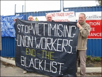 Manchester electricians protesting on 31.8.11 as part of protests around the country against the employers' assault on pay and conditions. Simon, Steve and Sean (from left to right) leafleted outside the Carillion site in Denton, Manchester. Photo Hugh C.