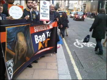 Locked-out Sotheby's workers and supporters behind banner, London 13.10.11, photo Kevin Parslow