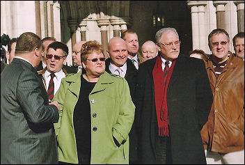 Brian Caton, Prison Officers Association  general secretary, joins protest outside the Royal Court of Justice. Photo Keith Dickinson