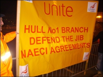 Banner outside ConocoPhilips' Humber refinery in Immingham, 14 December 2011, photo Alistair Tice
