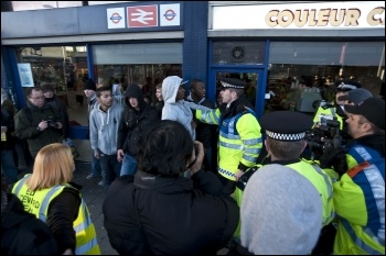 EDL demostration in Barking: A victim of EDL racist abuse is photographed by the Forward Intelligence Team and told to move on or face arrest
