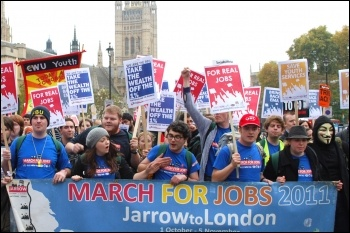 The 330 mile Jarrow-London march that Youth Fight for Jobs organised in October 2011, marching past Parliament, photo Sarah Wrack