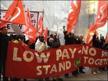 Intitial train cleaners striking for a living wage, St Pancras station, London 16.2.12, photo by Suzanne Beishon