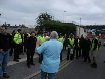 Kirklees admin workers' strike: Binmen being addressed by stewards who then voted not to cross the picket line, photo by Huddersfield SP