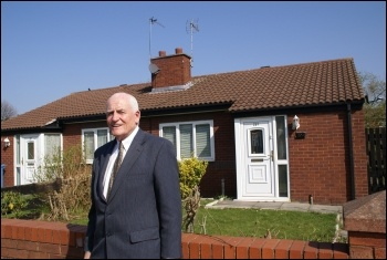 Tony Mulhearn in front of one of the houses built by Liverpool City Council in the 1980s, photo Harry Smith