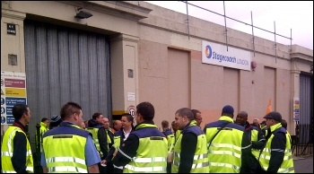 Bus drivers at the Longbridge Road bus garage in Barking out on the picket line , photo by Hannah Sell