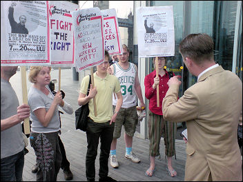 Protesters confront BNP GLA assembly member Richard Barnbrook, photo Bob Severn