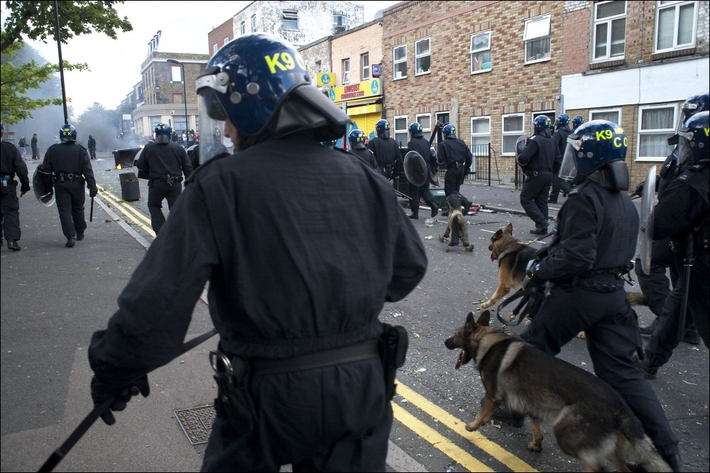 Riots: rioters and police in Hackney during August 2011 disturbances